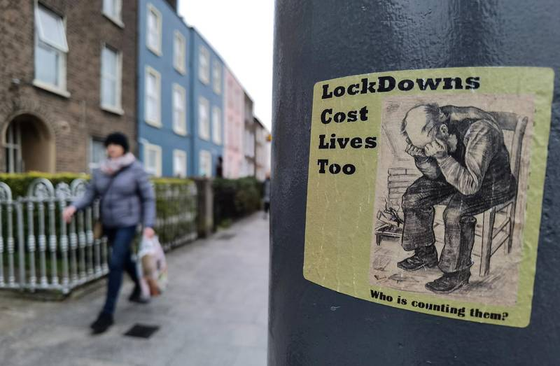 A sticker reading 'LockDowns Cost Lives Too' seen on a lamp post in Dublin during Level 5 Covid-19 lockdown.  On Tuesday, 9 March, 2021, in Dublin, Ireland. (Photo by Artur Widak/NurPhoto via Getty Images)