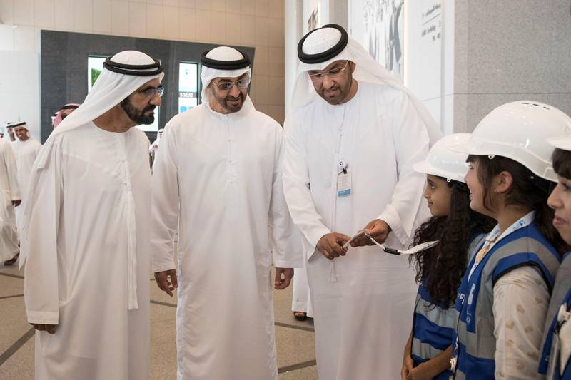 ABU DHABI, UNITED ARAB EMIRATES - July 30, 2017: HH Sheikh Mohamed bin Rashid Al Maktoum, Vice-President, Prime Minister of the UAE, Ruler of Dubai and Minister of Defence (L), HH Sheikh Mohamed bin Zayed Al Nahyan, Crown Prince of Abu Dhabi and Deputy Supreme Commander of the UAE Armed Forces (2nd L), and HE Dr Sultan Ahmed Al Jaber, UAE Minister of State, Chairman of Masdar and CEO of ADNOC Group (3rd L), greets children of Abu Dhabi National Oil Company (ADNOC) employees while visiting the ADNOC headquarters.( Ryan Carter / Crown Prince Court - Abu Dhabi )---