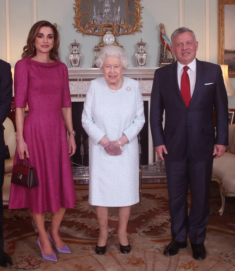 LONDON, ENGLAND - JANUARY 01: (L-R) Queen Rania of Jordan, Queen Elizabeth II and King Abdullah II of Jordan during a private audience at Buckingham Palace on January 1, 2019 in London, England. (Photo by Yui Mok - WPA Pool/Getty Images)