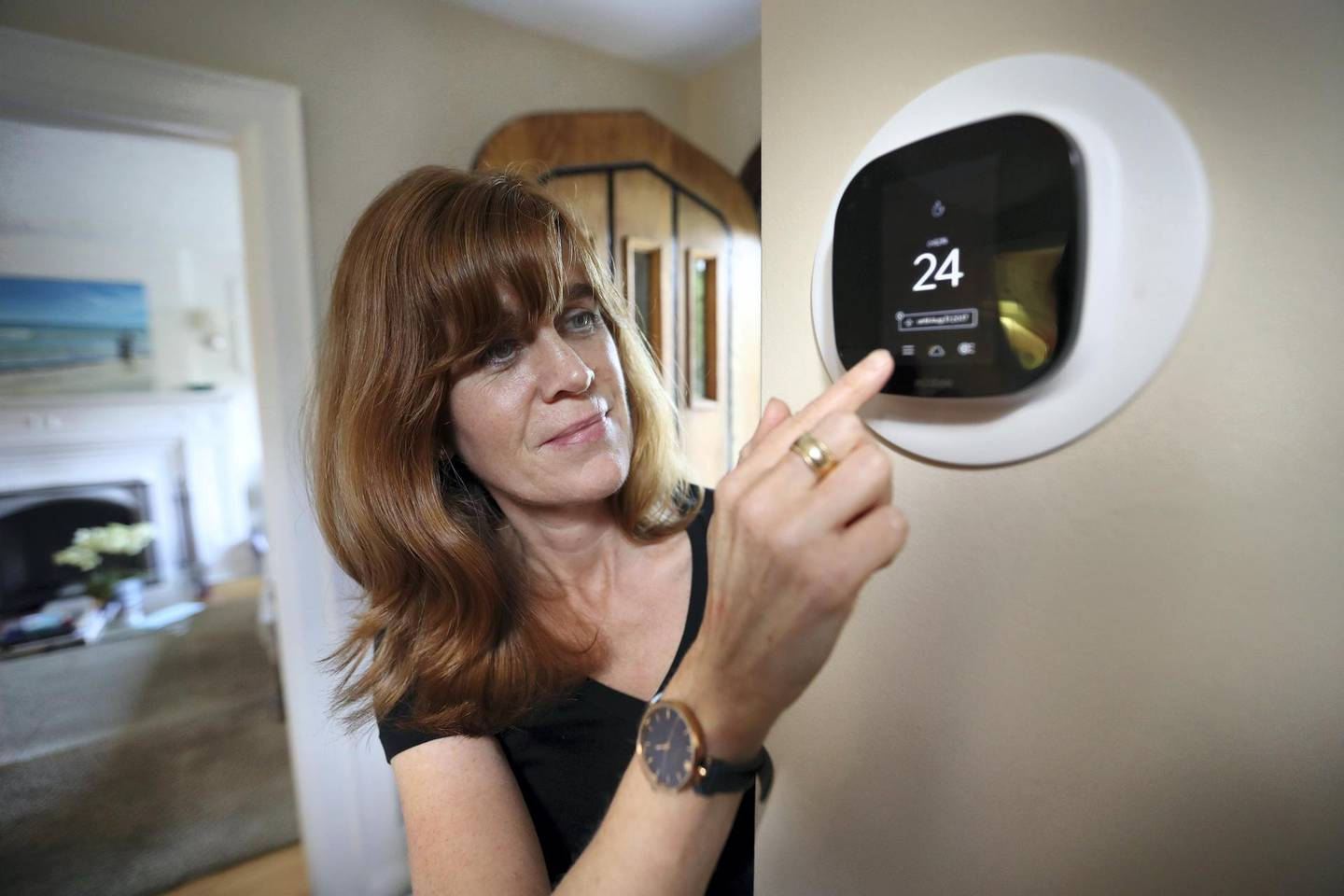TORONTO, ON - AUGUST, 30    Diana Carradine with Ecobee smart thermostat in her home in the Eglinton and Avenue road area.  The province is launching the Green Ontario Fund, bankrolled with $377 milion in cap-and-trade revenues, to help homeowners and businesses with programs to reduce their greenhouse gas emissions. The first move is offering free smart thermostats to eligible homeowners, so they can more easily turn down the heat or air conditioning when they're not âehome -- saving on natural gas and electricity.        (Richard Lautens/Toronto Star via Getty Images)