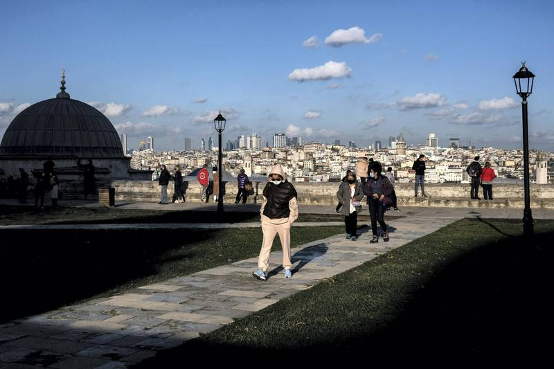 epa08920574 People wearing face masks at the garden of  Suleymaniye Mosque on sunny day  in Istanbul, Turkey, 05 January  2021.  EPA/SEDAT SUNA