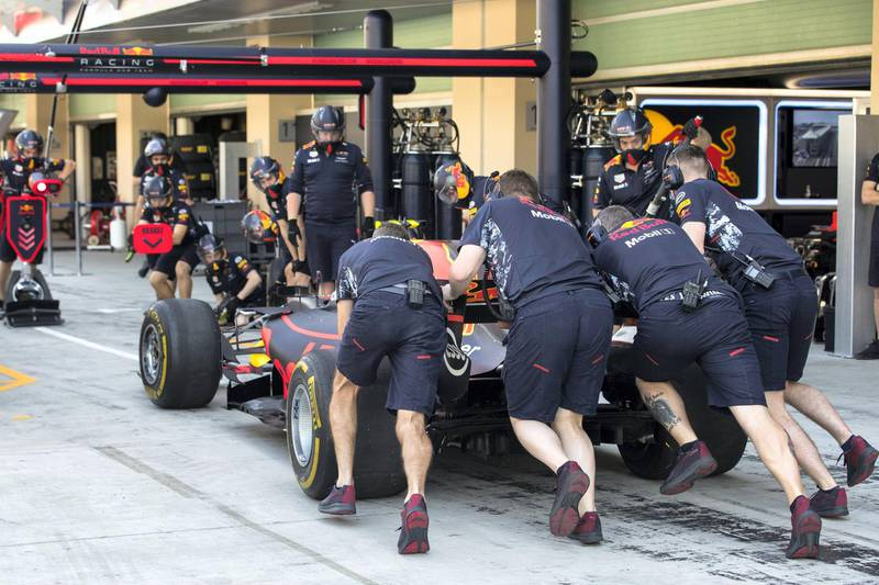 Abu Dhabi, United Arab Emirates, November 24, 2017:    Crew members push Max Verstappen of Belgium and Red Bull Racing car in the pits during practise for the Abu Dhabi Formula One Grand Prix at Yas Marina Circuit in Abu Dhabi on November 24, 2017. Christopher Pike / The National  Reporter: Graham Caygill Section: Sport
