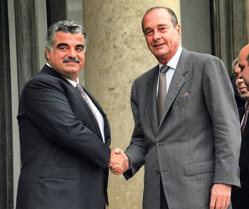 French President Jacques Chirac (R) greets Lebanese Prime Minister Rafic Hariri at the Elysee Palace in Paris, 28 September 1996. (Photo by PIERRE VERDY / POOL / AFP)