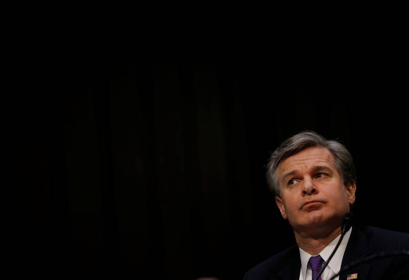 """Federal Bureau of Investigation (FBI) Director Christopher Wray waits to testify during a Senate Intelligence Committee hearing on """"Worldwide Threats"""" on Capitol Hill in Washington, U.S., February 13, 2018. REUTERS/Leah Millis"""