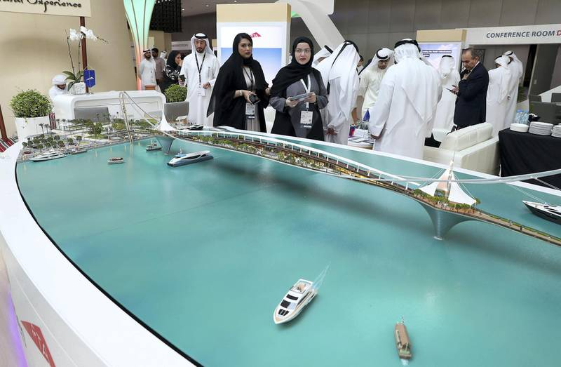 ABU DHABI,  UNITED ARAB EMIRATES , OCTOBER 6 – 2019 :- Delegates looking at the model of Dubai Sky Garden at the UAE stand during the 26th World Road Congress exhibition held at Abu Dhabi National Exhibition Center in Abu Dhabi. ( Pawan Singh / The National ) For News. Story by Patrick