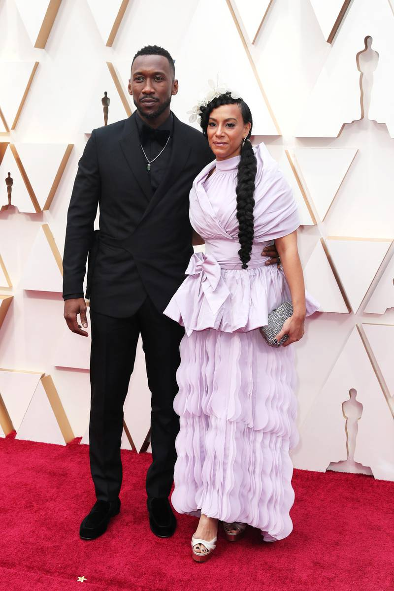 epa08207427 Amatus Sami-Karim (R) and Mahershala Ali (L) arrive for the 92nd annual Academy Awards ceremony at the Dolby Theatre in Hollywood, California, USA, 09 February 2020. The Oscars are presented for outstanding individual or collective efforts in filmmaking in 24 categories.  EPA-EFE/DAVID SWANSON