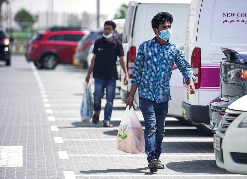 Abu Dhabi, United Arab Emirates, April 5, 2020.  Grocery shoppers with face mask s on at Souk Planet, Khalifa City.  Face masks should be worn at all times when outside the home, the UAE government said on Saturday.      Victor Besa / The National