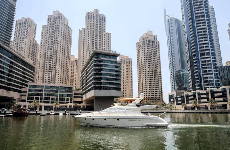 A luxury yacht is pictured at the Dubai Marina Beach in the Gulf emirate, on June 10 2021.  Dubai earned a reputation for delivering luxury for those with cash to splash years ago, but amid the Covid-19 pandemic, a new mode of travel has become popular, yachts. Charter companies said they have seen an increased interest in yachting after coronavirus measures eased, especially among those who want to spend time with friends and family. / AFP / Karim SAHIB