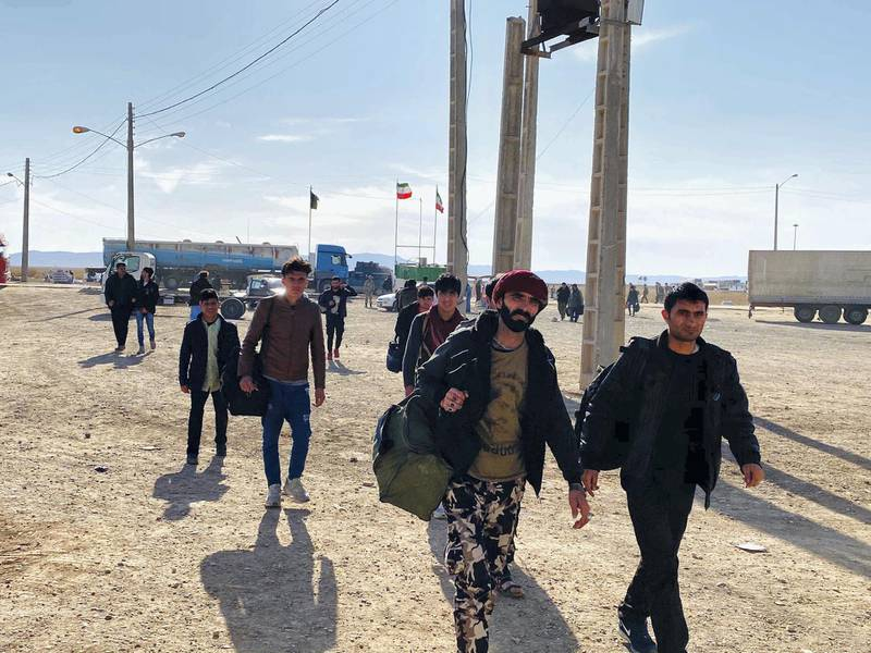 Afghan deportees arrive at Zero Point, an area between Iran and Afghanistan border where they are dropped off by Iranian authorities. Iran has forcefully deported over 250,000 Afghans back to a country where violence has been on a steady rise. Photo by Hikmat Noori