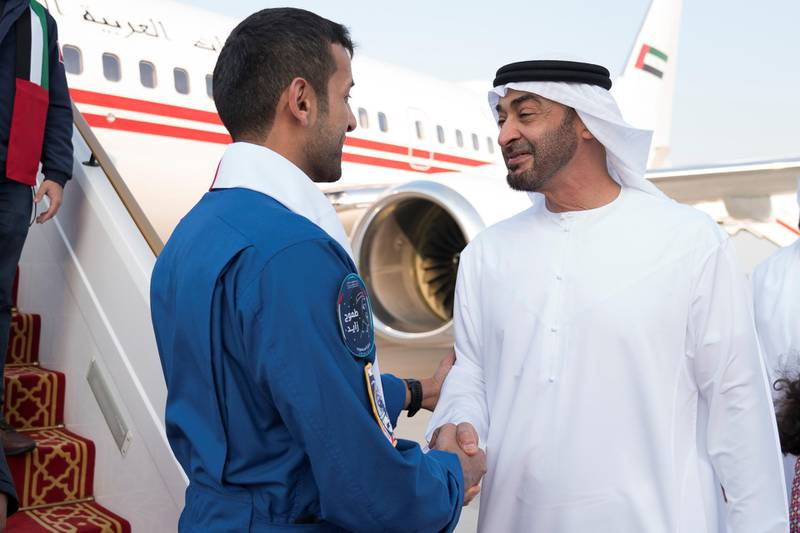 ABU DHABI, UNITED ARAB EMIRATES - October 12, 2019: HH Sheikh Mohamed bin Zayed Al Nahyan, Crown Prince of Abu Dhabi and Deputy Supreme Commander of the UAE Armed Forces (R), receives Sultan Saif Al Neyadi, a member of the International Space Station (ISS) mission back-up team (L), during a homecoming reception at the Presidential Airport.    ( Mohamed Al Hammadi / Ministry of Presidential Affairs ) ---