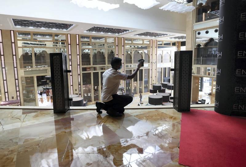 Dubai, United Arab Emirates - Reporter: N/A. Standalone. Covid-19/Coronavirus. Kamal disinfects different surfaces at the H Hotel in Dubai. Thursday, August 27th, 2020. Dubai. Chris Whiteoak / The National