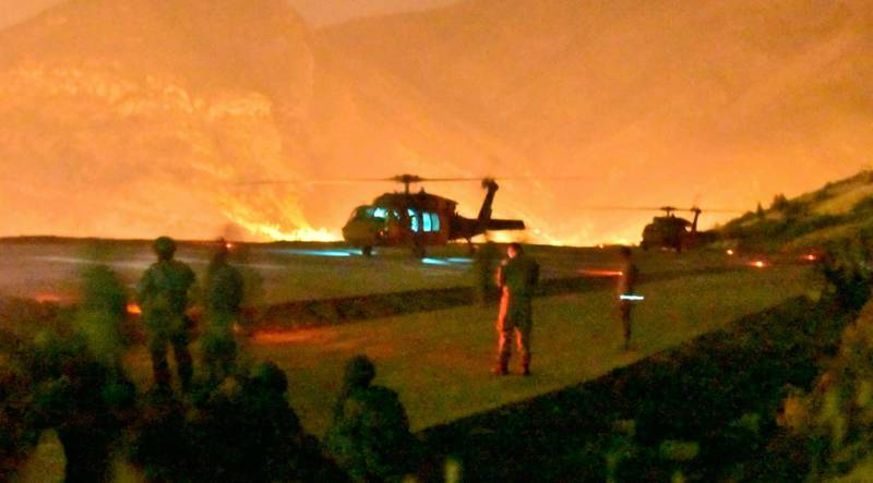 In this photo provided by the Turkish Ministry of Defence on Wednesday, June 17, 2020, Turkish troops in action against Kurdish militants in northern Iraq. Turkey says it has airlifted troops for a cross-border ground operation against Turkey's Kurdish rebels in northern Iraq. The Defense Ministry in Ankara says the airborne offensive in Iraq's border region of Haftanin was launched on Wednesday following intense artillery fire into the area. The ministry says commando forces are being supported by warplanes, attack helicopters, artillery and armed and unarmed drones. (Turkish Ministry of Defence via AP)