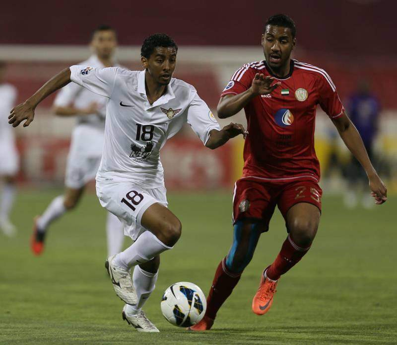 Qatar's Al-Jaish player Mohammed El-Sayed Jedo (L) challenges Khamis Ismail (R) of UAE's Al-Jazira club during their AFC Champions League soccer match in Doha on April 2, 2013. AFP PHOTO /AL-WATAN DOHA / KARIM JAAFAR == QATAR OUT  *** Local Caption ***  017766-01-08.jpg