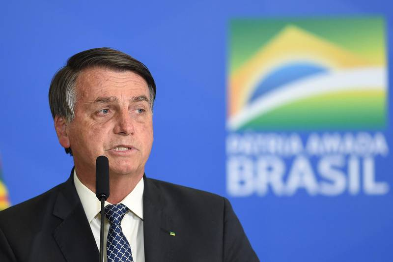 Brazilian President Jair Bolsonaro delivers a speech during the signing ceremony of a new decree that facilitates access to credit for small business and fights the economic impacts resulting from the pandemic of the novel coronavirus, at Planalto Palace in Brasilia, on August 19, 2020. (Photo by EVARISTO SA / AFP)