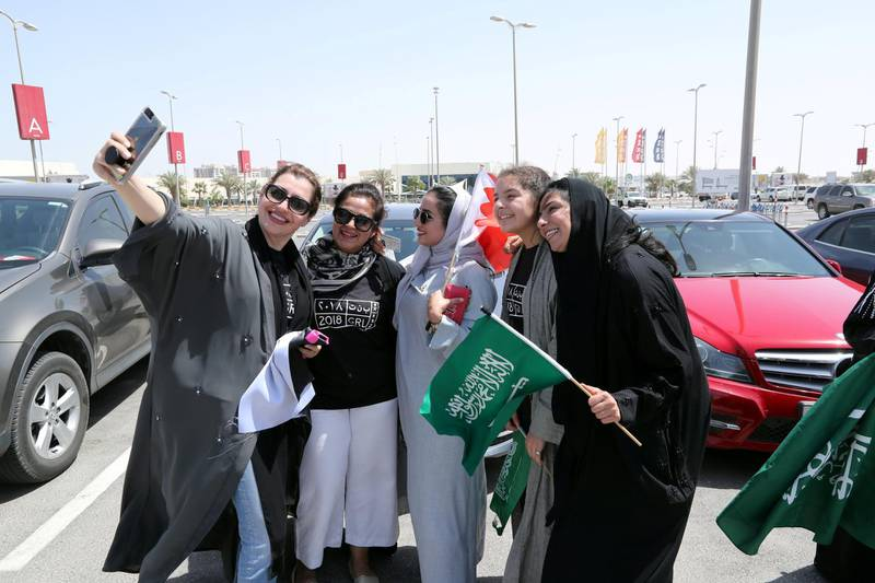 Bahraini and Saudi women celebrate the lifting of the driving ban on women in east Saudi Arabia, June 24, 2018. REUTERS/Hamad I Mohammed