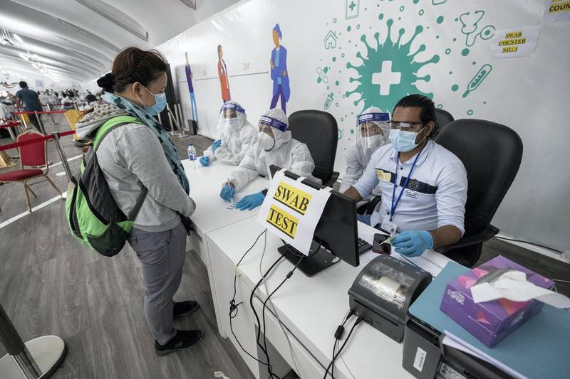 ABU DHABI, UNITED ARAB EMIRATES. 05 AUGUST 2020. The DPI Screening facility along the border between Dubai and Abu Dhabi which screens travellers for the COVID-19 virus using a blood sample and laser technology. It is a quick blood test and results are out in a matter of minutes. Regine Upod undertakes the secondary swab test. (Photo: Antonie Robertson/The National) Journalist: Nick Webster. Section: National.
