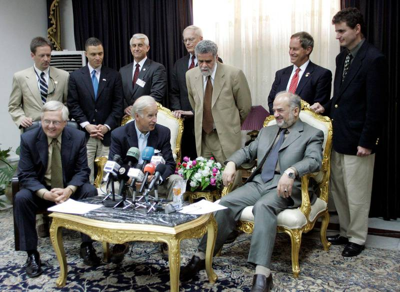 Iraqi Prime Minister Ibrahim Jaafari (seated, R) meets the press after a meeting with and Curt Weldon (L), the head of a US congressional delegation of about a half-dozen members that also includes Rep. Joe Wilson, Rep. Jeff Miller, Rep. Harold Ford, Rep. Mark Green, David Reichert, and Senator Joe Biden, in Baghdad 30 May 2005. AFP PHOTO/POOL/ALI HAIDAR (Photo by ALI HAIDAR / POOL / AFP)