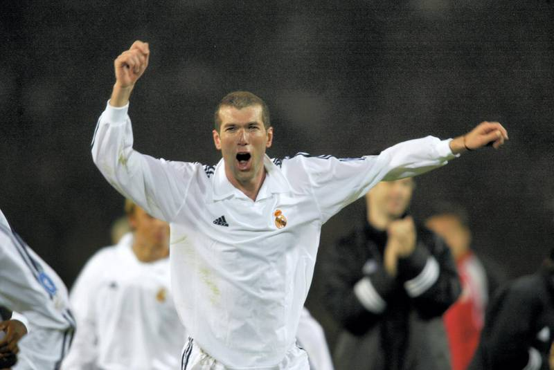 GLASGOW - May 15:  Zinedine Zidane of Real Madrid celebrates winning the cup after the UEFA Champions League Final between Real Madrid and Bayer Leverkusen played at Hampden Park, in Glasgow, Scotland on May 15, 2002. Real Madrid won the match and cup 2-1. DIGITAL IMAGE. (Photo by Gary M. Prior/Getty Images)