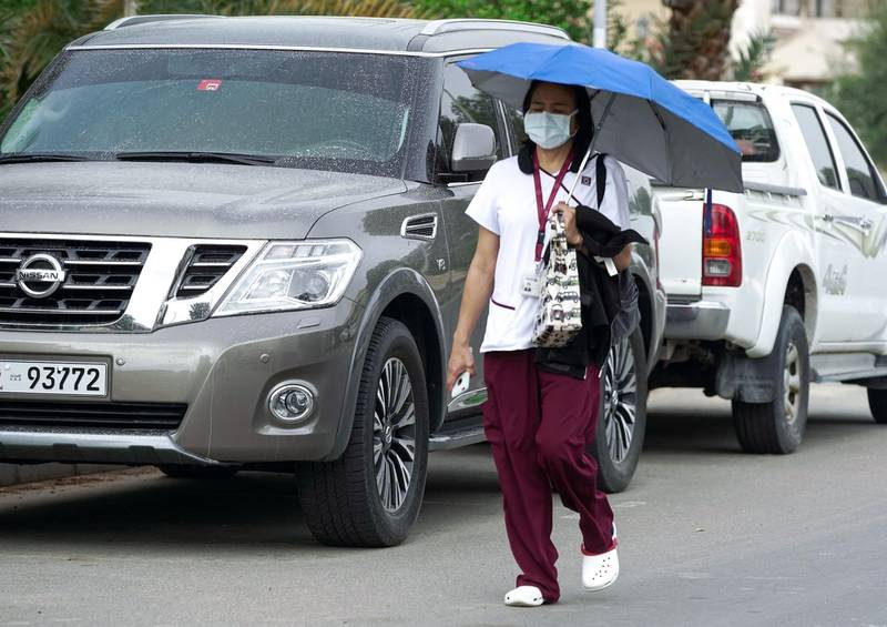 Abu Dhabi, United Arab Emirates, March 30, 2020.  A healthcare worker on her way to work on a gloomy Monday morning at the Al Mushrif area Abu Dhabi.                              Victor Besa / The National Section:  NA Reporter:
