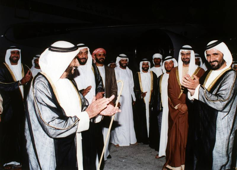 Sheikh Zayed Bin Sultan Al Nahyan being welcomed by Sheikh Khalifa Bin Zayed Al Nahyan, Sheikh Mohammed Bin Rashid Al Maktoum, Sheikh Mohammed Bin Zayed Al Nahyan and Sheikh Sultan Bin Zayed Al Nahyan upon his return to the UAE, 5th September 1995 National Archives images supplied by the Ministry of Presidential Affairs to mark the 50th anniverary of Sheikh Zayed Bin Sultan Al Nahyan becaming the Ruler of Abu Dhabi. *** Local Caption ***  86 b.jpg