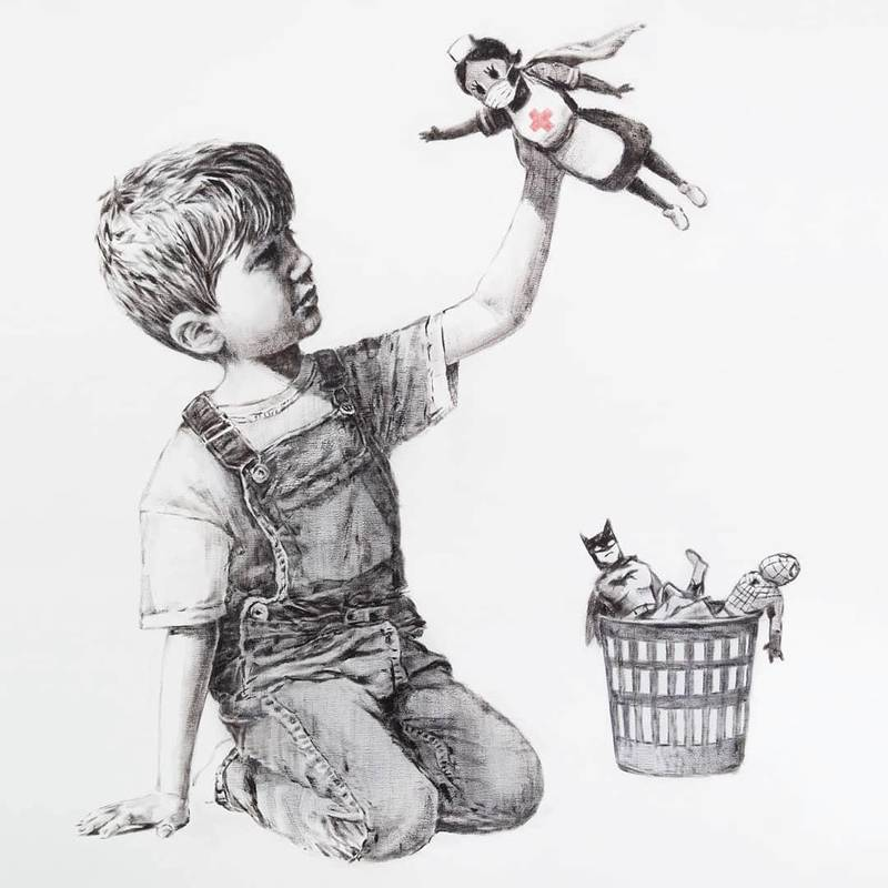 """A picture shows a drawing created by the street artist Banksy called """"Game Changer"""" as an appreciation for the NHS and is on display at Southampton General Hospital, in Southampton, Britain May 6, 2020 in this picture obtained from social media. It shows a boy dressed in dungarees playing with a nurse superhero toy with figures of Batman and Spiderman discarded in a basket on the floor. @BANKSY INSTRAGRAM/via REUTERS THIS IMAGE HAS BEEN SUPPLIED BY A THIRD PARTY. MANDATORY CREDIT. NO RESALES. NO ARCHIVES."""