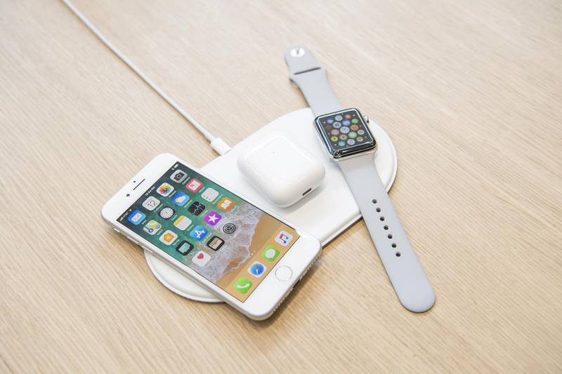 The Apple Inc. iPhone 8, Airpods, and Apple Watch sit on the AirPower charger during an event at the Steve Jobs Theater in Cupertino, California, U.S., on Tuesday, Sept. 12, 2017. Apple Inc. unveiled its most important new iPhone for years to take on growing competition from Samsung Electronics Co., Google and a host of Chinese smartphone makers. The device, coming a decade after the original model, is Apple's first major redesign since 2014 and represents a significant upgrade to the iPhone 7 line. Photographer: David Paul Morris/Bloomberg
