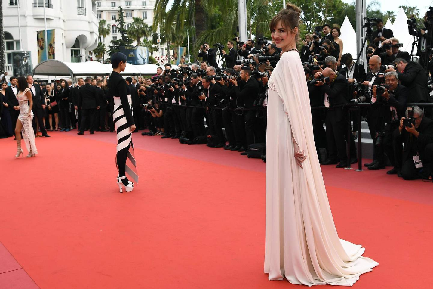 """(FromR) French actress Louise Bourgoin, Chinese actress and singer Li Yuchun and US actress Chantel Jeffries pose as they arrive on May 9, 2018 for the screening of the film """"Yomeddine"""" at the 71st edition of the Cannes Film Festival in Cannes, southern France.  / AFP PHOTO / Anne-Christine POUJOULAT"""