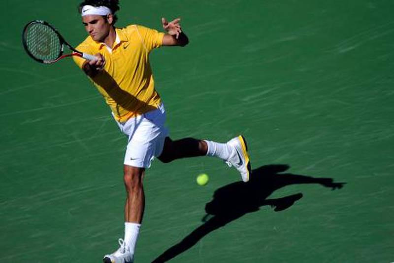 epa02635680 Roger Federer of Switzerland returns a shot to Juan Ignacio Chela of Argentina  during their match at the BNP Paribas Open in Indian Wells, California, USA 15 March 2011. Federer defeated Chela 6-0, 6-2.  EPA/PAUL BUCK *** Local Caption ***  02635680.jpg