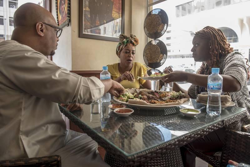 Abu Dhabi, UAE, 8 September 2017:Meley Tsegaye (middle)owner of Bonna Anne , an Ethopian, Restaurant and Rosalind Hester  at Bonna Anne Restaurant, Tourist club,Abu Dhabi, UAE, Vidhyaa for The National