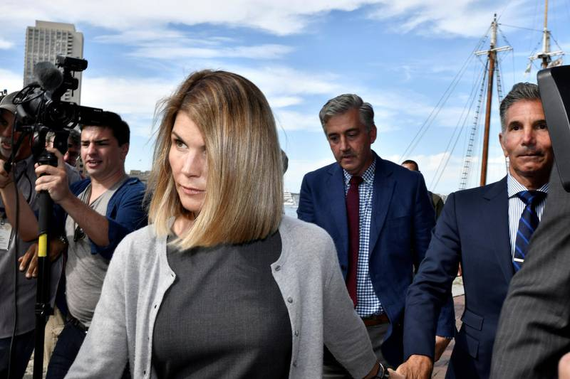 FILE PHOTO: Actress Lori Loughlin, and her husband, fashion designer Mossimo Giannulli leave the federal courthouse after a hearing on charges in a nationwide college admissions cheating scheme in Boston, Massachusetts, U.S., August 27, 2019.  REUTERS/Josh Reynolds/File Photo