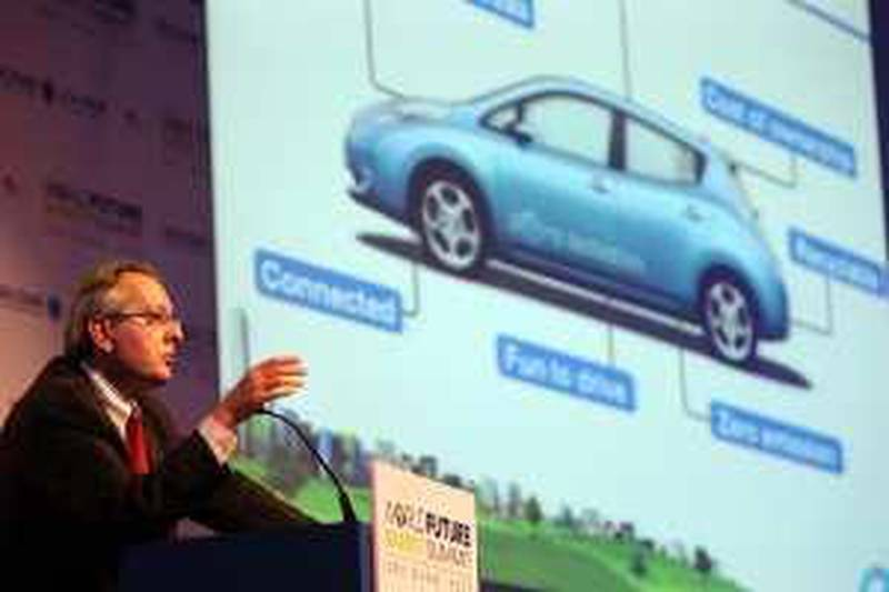 ABU DHABI  20th January 2010. WORLD FUTURE ENERGY SUMMIT. DAY 3. Pierre Loing, from Nissan with an image of Nissan's first mass market electric vehicle at the World Future Energy Summit in Abu Dhabi yesterday(weds)  Stephen Lock   /  The National  .  *** Local Caption ***  SL-energydaythree-015.jpg
