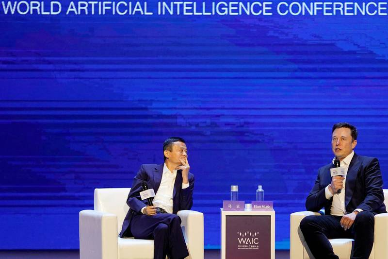 Tesla Inc CEO Elon Musk and Alibaba Group Holding Ltd Executive Chairman Jack Ma attend the World Artificial Intelligence Conference (WAIC) in Shanghai, China, August 29, 2019. REUTERS/Aly Song     TPX IMAGES OF THE DAY