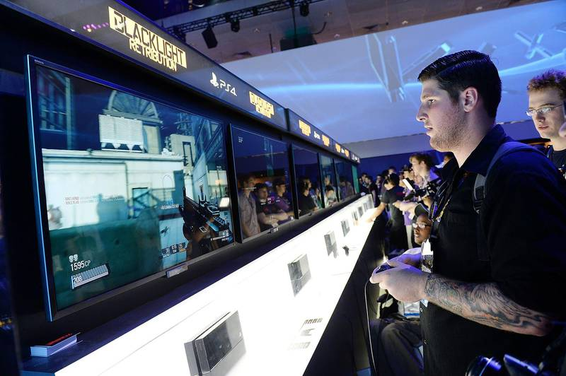 LOS ANGELES, CA - JUNE 11:  Gamers try out the new Sony Playstation 4 at the 2013 E3 Electronic Entertainment Expo at Los Angeles Convention Center on June 11, 2013 in Los Angeles, California.  (Photo by Michael Kovac/WireImage)