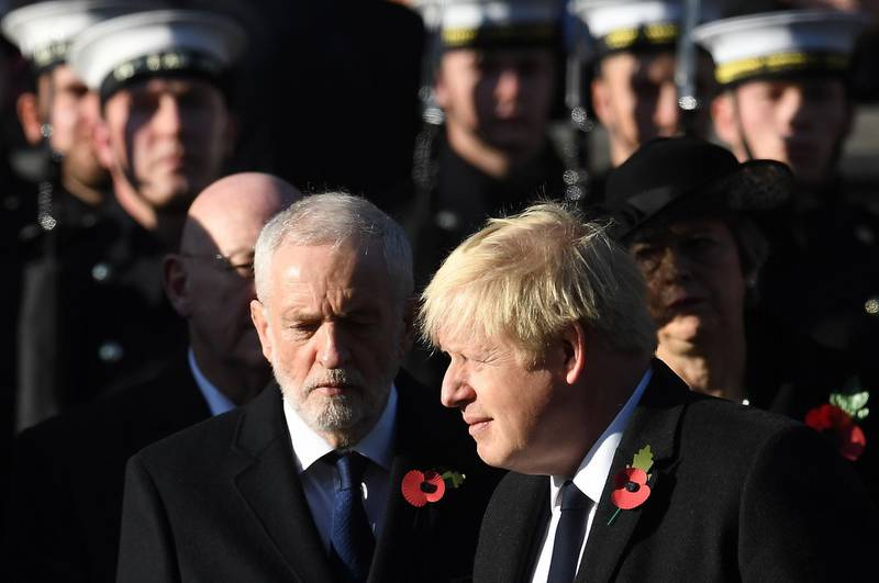 epa07985864 British Prime Minister Boris Johnson (R) with Labour Party leader Jeremy Corbyn (L)  at the Cenotaph on Whitehall during the Remembrance Sunday day service in London, Britain, 10 November 2019.  Britain is remembering its war dead on the 101st anniversary since the end of the first world war.  EPA/ANDY RAIN