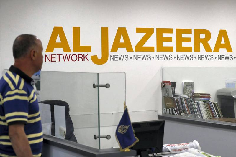 Employees of Qatar based news network and TV channel Al-Jazeera are seen at their Jerusalem office on July 31, 2017, Israel said on August 6, 2017 that it planned to close the offices of Al-Jazeera after Prime Minister Benjamin Netanyahu accused the Arab satellite news broadcaster of incitement. A statement from the communications ministry said it would demand the revocation of the credentials of journalists working for the channel and also cut its cable and satellite connections. / AFP PHOTO / AHMAD GHARABLI