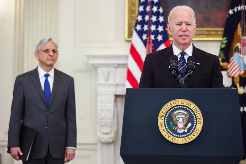 U.S. President Joe Biden speaks beside Merrick Garland, U.S. attorney general, in the Roosevelt Room of the White House in Washington, D.C., U.S., on Wednesday, June 23, 2021. President Biden will launch a comprehensive plan to curb gun crime, including by allowing states and municipalities to tap into coronavirus relief funding to hire police officers under certain circumstances. Photographer: Oliver Contreras/Sipa/Bloomberg