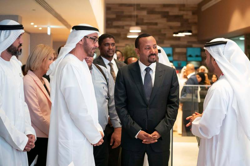 ABU DHABI, UNITED ARAB EMIRATES - March 20, 2019: HH Sheikh Mohamed bin Zayed Al Nahyan, Crown Prince of Abu Dhabi and Deputy Supreme Commander of the UAE Armed Forces (2nd L) and HE Abiy Ahmed, Prime Minister of Ethiopia (3rd L), tour the Special Olympics World Games Abu Dhabi 2019 at Abu Dhabi National Exhibition Centre. Seen with Khalfan Al Mazrouei, Managing Director at Special Olympics World Games Abu Dhabi 2019 (R) and HE Mohamed Mubarak Al Mazrouei, Undersecretary of the Crown Prince Court of Abu Dhabi (L).   ( Mohamed Al Hammadi / Ministry of Presidential Affairs ) ---