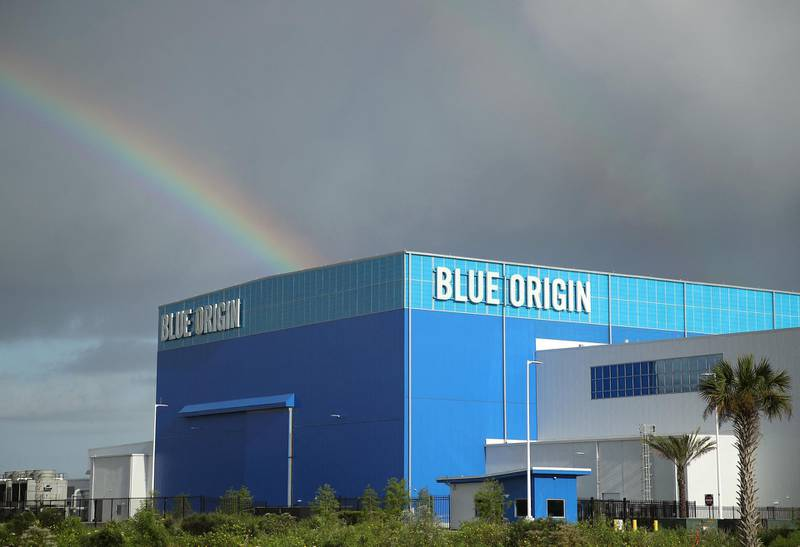 CAPE CANAVERAL, FLORIDA - AUGUST 31: Storm clouds and a rainbow appear over Jeff Bezos Blue Origin Aerospace Manufacturer building as Hurricane Dorian approaches Florida, on August 31, 2019 in Cape Canaveral, Florida. Dorian could be a Category 4 storm as it approaches the state and possibly making landfall as early as Monday somewhere along the east coast.   Mark Wilson/Getty Images/AFP (Photo by MARK WILSON / GETTY IMAGES NORTH AMERICA / Getty Images via AFP)