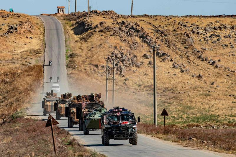 Russian and Turkish military vehicles, baring traces of objects and liquids thrown at them by Kurdish protesters, take part in a joint Turkish-Russian patrol near the town of Al-Muabbadah in the northeastern Syrian Hassake province on the border with Turkey, on November 8, 2019.   / AFP / Delil SOULEIMAN