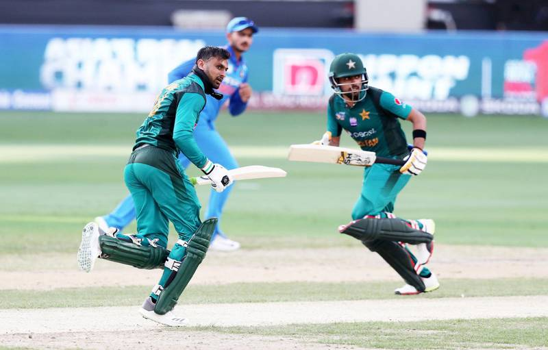 DUBAI , UNITED ARAB EMIRATES, September 19 , 2018 :- Left to Right – Shoaib Malik and Babar Azam of Pakistan running between the wickets during the Asia Cup UAE 2018 cricket match between Pakistan vs India held at Dubai International Cricket Stadium in Dubai. ( Pawan Singh / The National )  For Sports/Instagram. Story by Paul