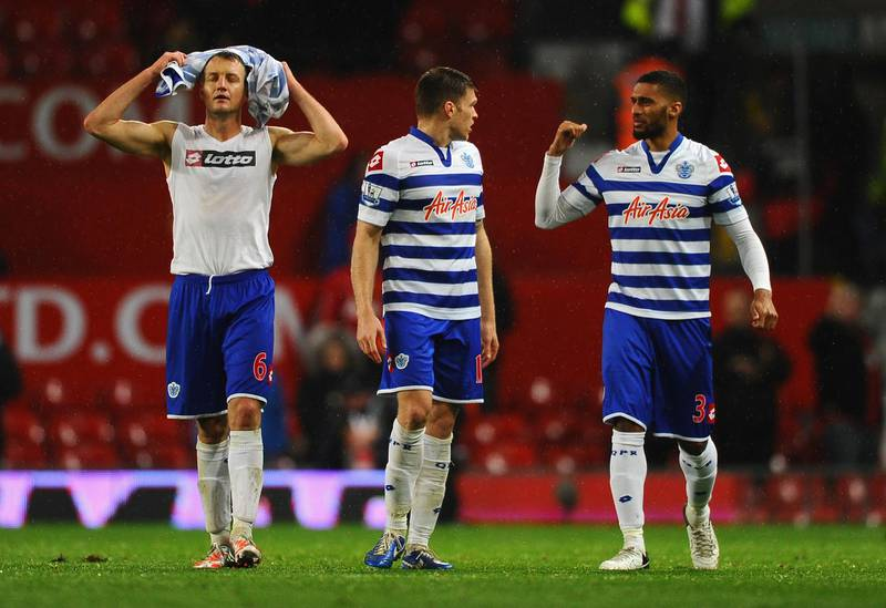 MANCHESTER, ENGLAND - NOVEMBER 24:  Clint Hill of Queens Park Rangers and his team-mates look dejected at the end of the Barclays Premier League match between Manchester United and Queens Park Rangers at Old Trafford on November 24, 2012 in Manchester, England.  (Photo by Laurence Griffiths/Getty Images)