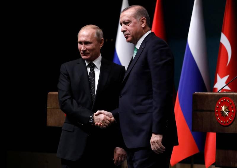 Turkish President Tayyip Erdogan shakes hands with Russian President Vladimir Putin after a news conference in Ankara, Turkey, December 11, 2017. REUTERS/Umit Bektas