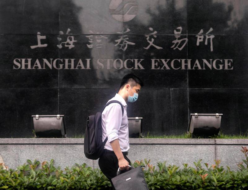 epa08535746 A man walks in front of the Stock Exchange Building in Shanghai, China, 08 July 2020 (issued 09 July 2020). China's Consumer Price Index (CPI), a main gauge of inflation, is rose 2.5 percent year-on-year in June 2020, according to National Bureau of Statistics report published on 09 June 2020, for the fifth consecutive month. The Producer-Price Index (PPI) dropped 3.0 percent year-on-year in June 2020.  EPA/ALEX PLAVEVSKI