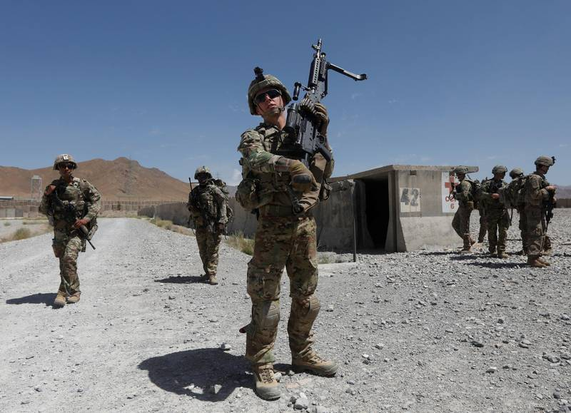 FILE PHOTO: U.S. troops patrol at an Afghan National Army (ANA) base in Logar province, Afghanistan August 7, 2018. REUTERS/Omar Sobhani/File Photo