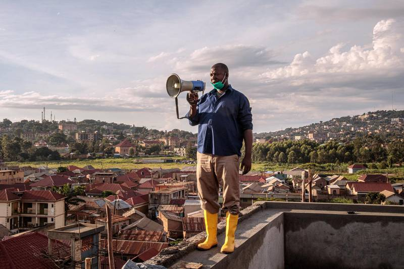 Gonzaga Yiga, a 49-year-old community chairperson, appeals to residents through a speaker from the tallest building of the area in morning and evening, on how to curb the COVID-19 coronavirus, in Kampala, Uganda, on March 24, 2020. (Photo by Badru KATUMBA / AFP)