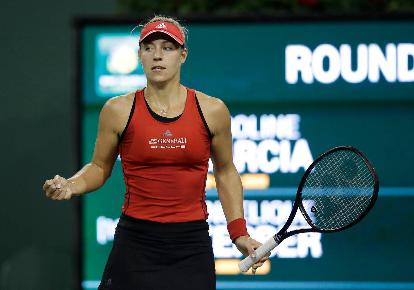 epa06602236 Angelique Kerber of Germany in action against Caroline Garcia of France during the BNP Paribas Open tennis tournament at the Indian Wells Tennis Garden in Indian Wells, California, USA, 13 March 2018.  EPA/PAUL BUCK