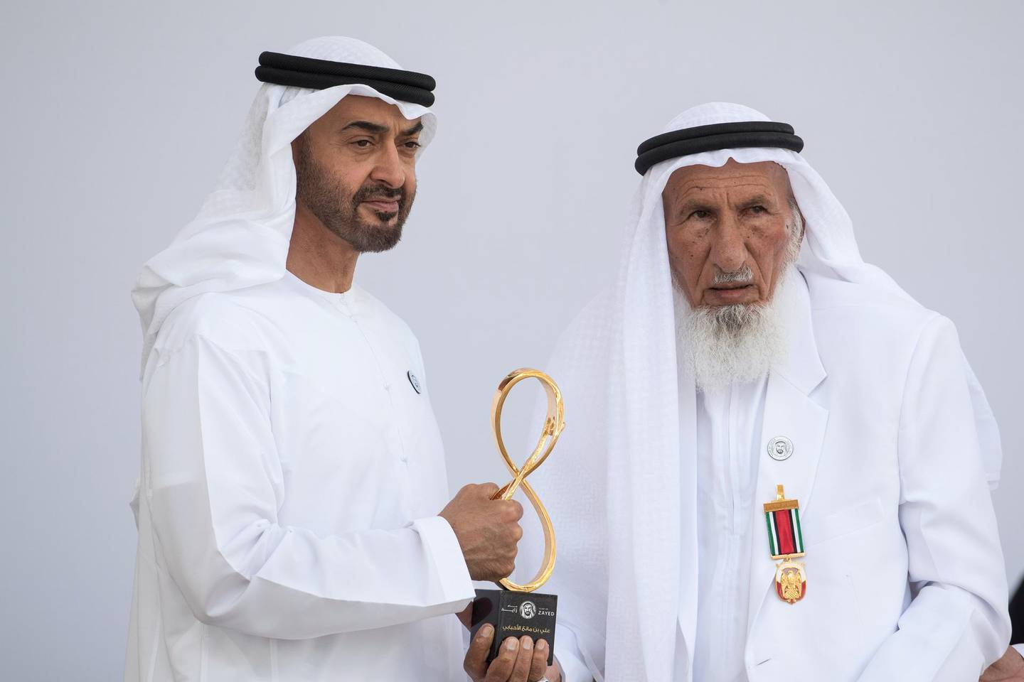 ABU DHABI, UNITED ARAB EMIRATES -  March 12, 2018: HH Sheikh Mohamed bin Zayed Al Nahyan, Crown Prince of Abu Dhabi and Deputy Supreme Commander of the UAE Armed Forces (L), presents an Abu Dhabi Award to Ali bin Manea Al Ahbabi (R), during the awards ceremony at the Sea Palace. ( Ryan Carter for the Crown Prince Court - Abu Dhabi ) ---