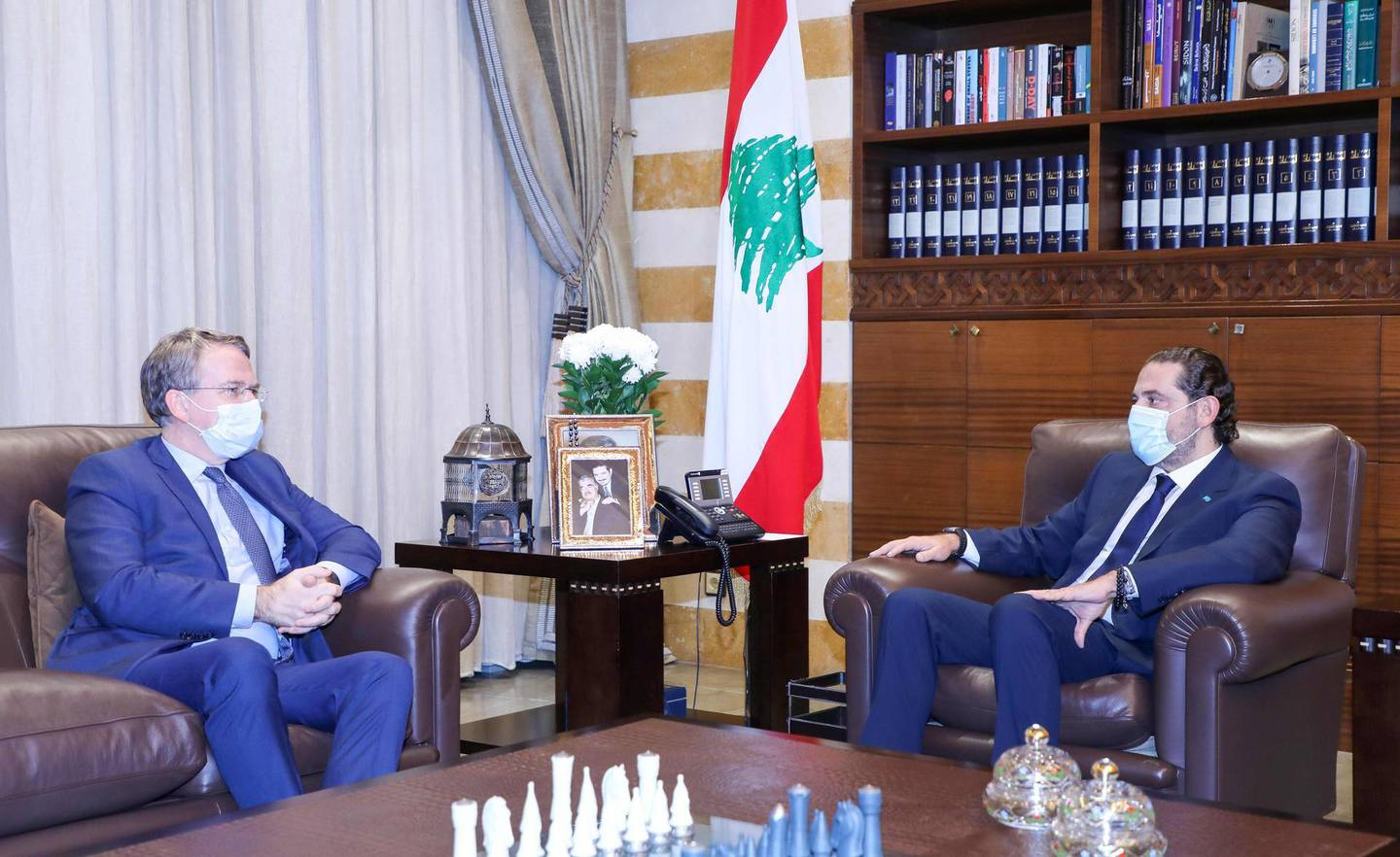 """A handout picture provided by the Lebanese photo agency Dalati and Nohra on November 12, 2020, shows prime minister-designate Saad Hariri (R) meeting with Patrick Durel (R), an adviser to French President Emmanuel Macron, in the capital Beirut. === RESTRICTED TO EDITORIAL USE - MANDATORY CREDIT """"AFP PHOTO / HO / DALATI AND NOHRA"""" - NO MARKETING - NO ADVERTISING CAMPAIGNS - DISTRIBUTED AS A SERVICE TO CLIENTS ===  / AFP / DALATI AND NOHRA / STRINGER / === RESTRICTED TO EDITORIAL USE - MANDATORY CREDIT """"AFP PHOTO / HO / DALATI AND NOHRA"""" - NO MARKETING - NO ADVERTISING CAMPAIGNS - DISTRIBUTED AS A SERVICE TO CLIENTS ==="""