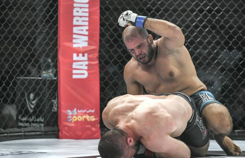 Abu Dhabi, United Arab Emirates - The light heavy-weight round Oli Thompson from Great Britain vs. Tarek Suleiman from Syria at the UAE Warriors MMA event at the Mubadala Arena, Zayed Sports City. Khushnum Bhandari for The National