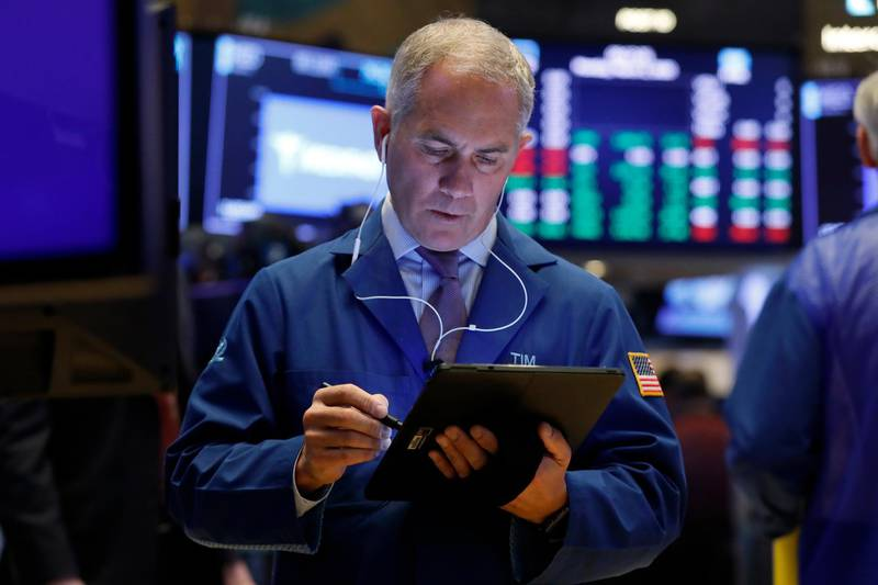 Trader Timothy Nick works on the floor of the New York Stock Exchange, Monday, March 2, 2020. Stocks are opening higher on Wall Street following a seven-day rout brought on by worries that the spreading coronavirus outbreak will stunt the global economy. (AP Photo/Richard Drew)
